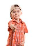 Kleiner Junge mit seinem Daumen oben stockbilder