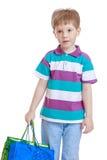 Kleiner Junge mit Taschen in ihren Händen Lizenzfreies Stockfoto