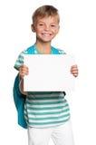 Kleiner Junge mit weißem Leerzeichen Lizenzfreies Stockfoto