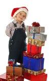 Kleiner Junge mit Weihnachtsgeschenken Stockfotografie