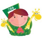 Kleiner Junge mit zwei Giraffen im Zoo Stockbild