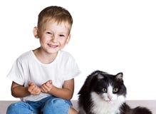 Kleiner Junge und große Katze Lizenzfreies Stockbild