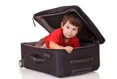 Kleiner Junge und Koffer Stockbilder