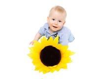 Kleiner Junge und Sonnenblume Lizenzfreie Stockfotos