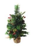 Kleiner künstlicher Weihnachtsbaum lokalisiert Stockfoto