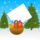 Kleiner Korb mit Geschenken mit dem leeren Blatt des Papiers Stockbild