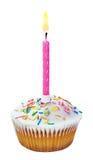 Kleiner Kuchen mit einer Geburtstagskerze Stockbilder