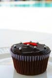 Kleiner Kuchen Poolside Stockbild