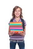 Kleiner Kursteilnehmer des smiley, der einige Bücher anhält Lizenzfreies Stockbild
