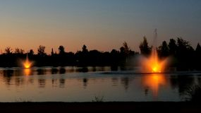 Kleiner Park, Meridian, Idaho. Fountain lights after sundown. Beautiful sunset after free concert at the park Royalty Free Stock Photos
