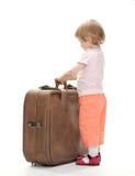 Kleiner Reisender, der für eine Reise sich vorbereitet Stockfotos