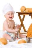 Kleiner Schätzchenchef im Kochkostüm Stockbilder