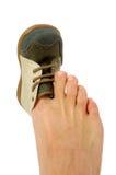 Kleiner Schuh des großen Fusses Lizenzfreies Stockbild