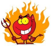 Kleiner Teufel mit Heugabel in den Flammen Stockfotos