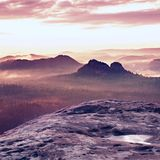 Kleiner Winterberg view. Fantastic dreamy sunrise on the top of the rocky mountain with the view into misty valley Royalty Free Stock Image