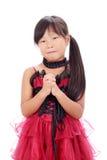 Kleines asiatisches betendes Mädchen Stockfotos