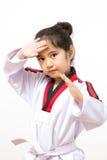 Kleines asiatisches Kind in kämpfender Aktion Lizenzfreie Stockfotografie