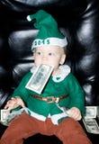 Kleines Baby mit Dollar im Mund lizenzfreies stockfoto