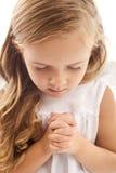 Kleines betendes Mädchen Stockfotos