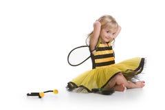 Kleines Bienen-Mädchen Stockfoto