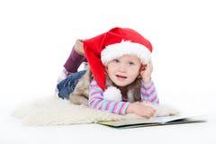 Kleines blondes Mädchen in einer Pelzjacke Stockbild