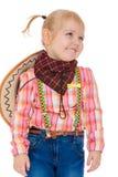 Kleines blondes Mädchen mit den Zöpfen gekleidet als Cowboy Stockfotos
