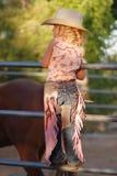 Kleines Cowgirl. Stockfotografie