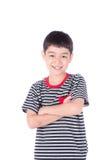 Kleines glückliches Jungenlächeln, das glückliches Gesicht des Kameraporträts betrachtet Lizenzfreies Stockfoto
