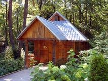 Kleines hölzernes Haus Stockfoto