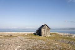 Kleines Haus auf dem Strand Stockbilder