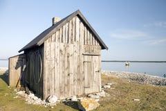 Kleines Haus auf dem Strand Stockfotos