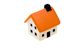 Kleines Haus auf weißem Hintergrund Lizenzfreie Stockfotografie