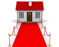 Kleines Haus mit rotem Teppich Stockbilder