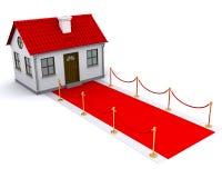 Kleines Haus mit rotem Teppich Lizenzfreies Stockfoto