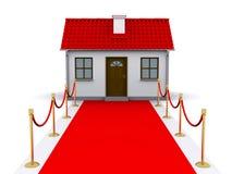 Kleines Haus und roter Teppich Stockbild
