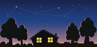 Kleines Haus und sternenklarer Himmel Stockfoto