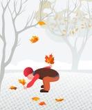 Kleines Kind, das gefallene Blätter sammelt Stockfotos