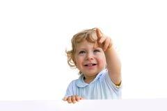 Kleines Kind, das sich zeigt Stockbilder