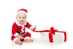 Kleines Kind gekleidet als Weihnachtsmann Stockfoto