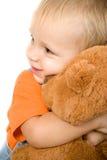 Kleines Kind mit Bären Stockfotos