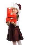 Kleines lächelndes Mädchen mit einem Geschenk Stockfotos