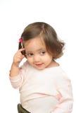 Kleines lächelndes und denkendes Mädchen Stockfotos