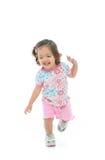 Kleines lächelndes und tanzendes Mädchen Stockfotos