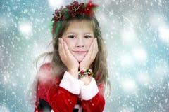 Kleines Mädchen als Sankt und Elfe Stockfotografie