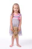 Kleines Mädchen auf einem weißen Hintergrund Stockfoto