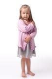 Kleines Mädchen auf einem weißen Hintergrund Lizenzfreie Stockfotos