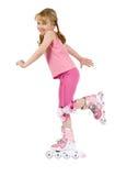 Kleines Mädchen auf Rollerochen Stockbilder