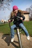 Kleines Mädchen auf Spielplatz Lizenzfreie Stockfotos