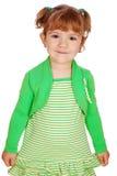 Kleines Mädchen bei der Kleidaufstellung Lizenzfreies Stockfoto