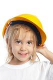 Kleines Mädchen, das gelben harten Hut trägt Lizenzfreie Stockfotos